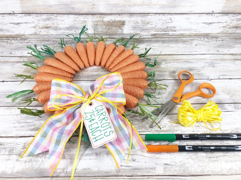 carrot wreath with scissors, ribbon, and markers