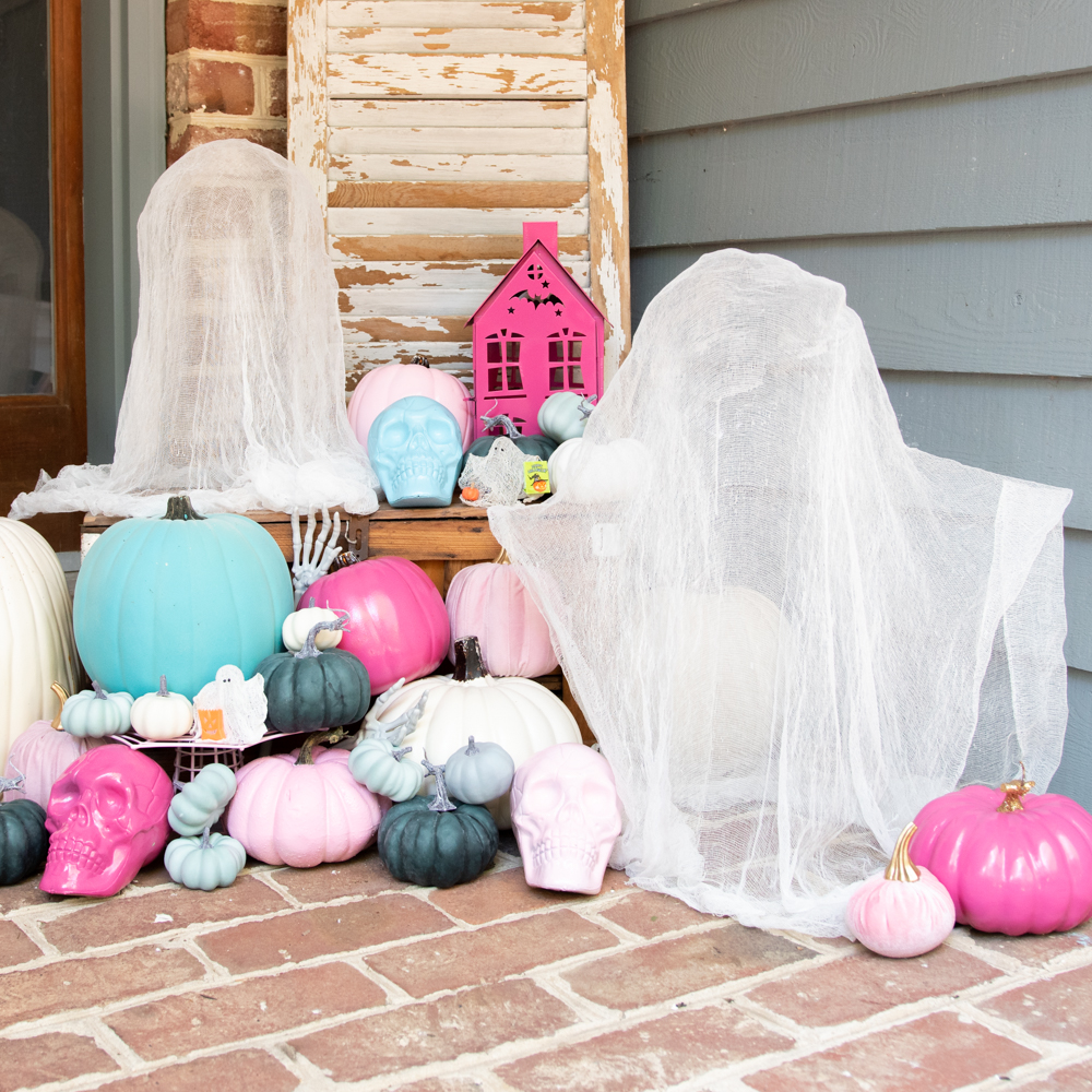 cheesecloth ghosts with bright pumpkins