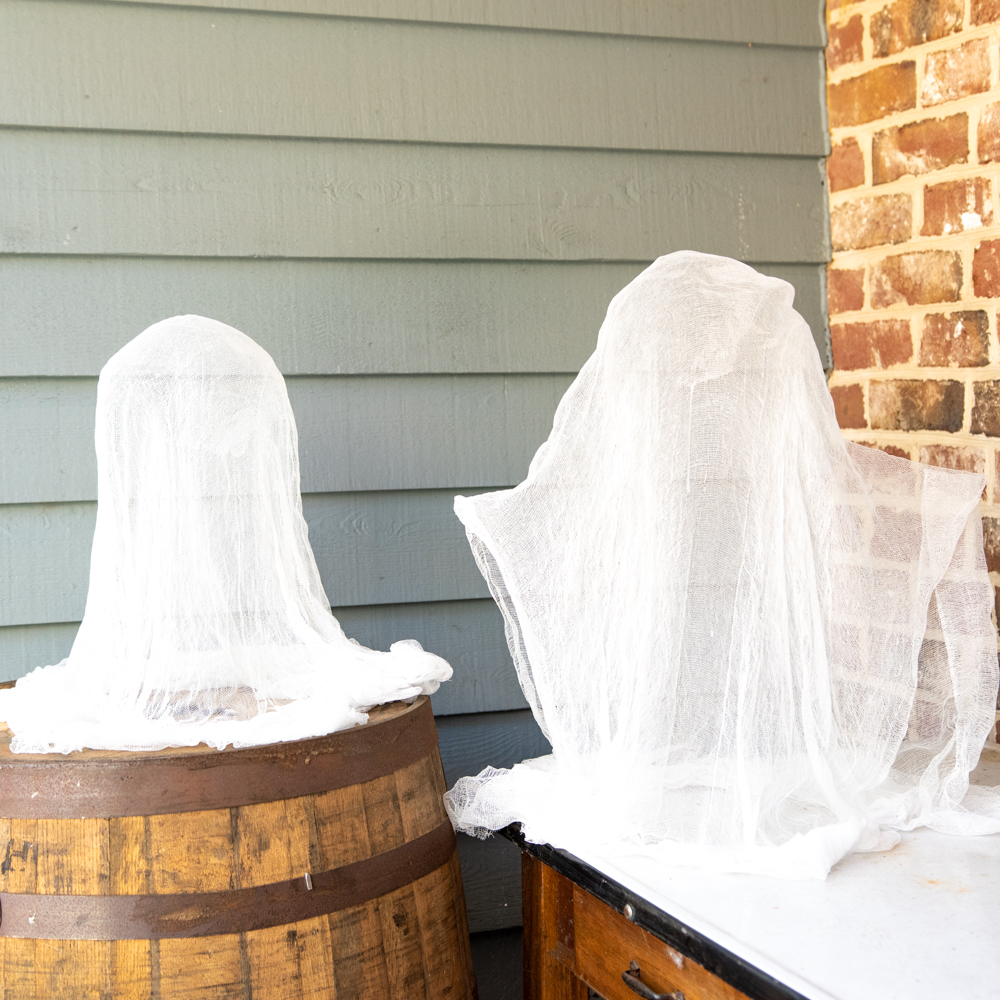 cheesecloth ghosts sitting outside