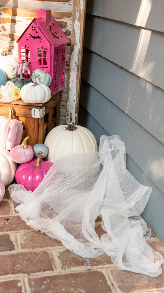 cheesecloth ghost melted on porch