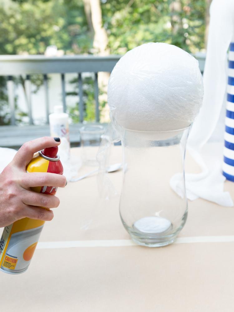 woman spraying foam ball with Pam